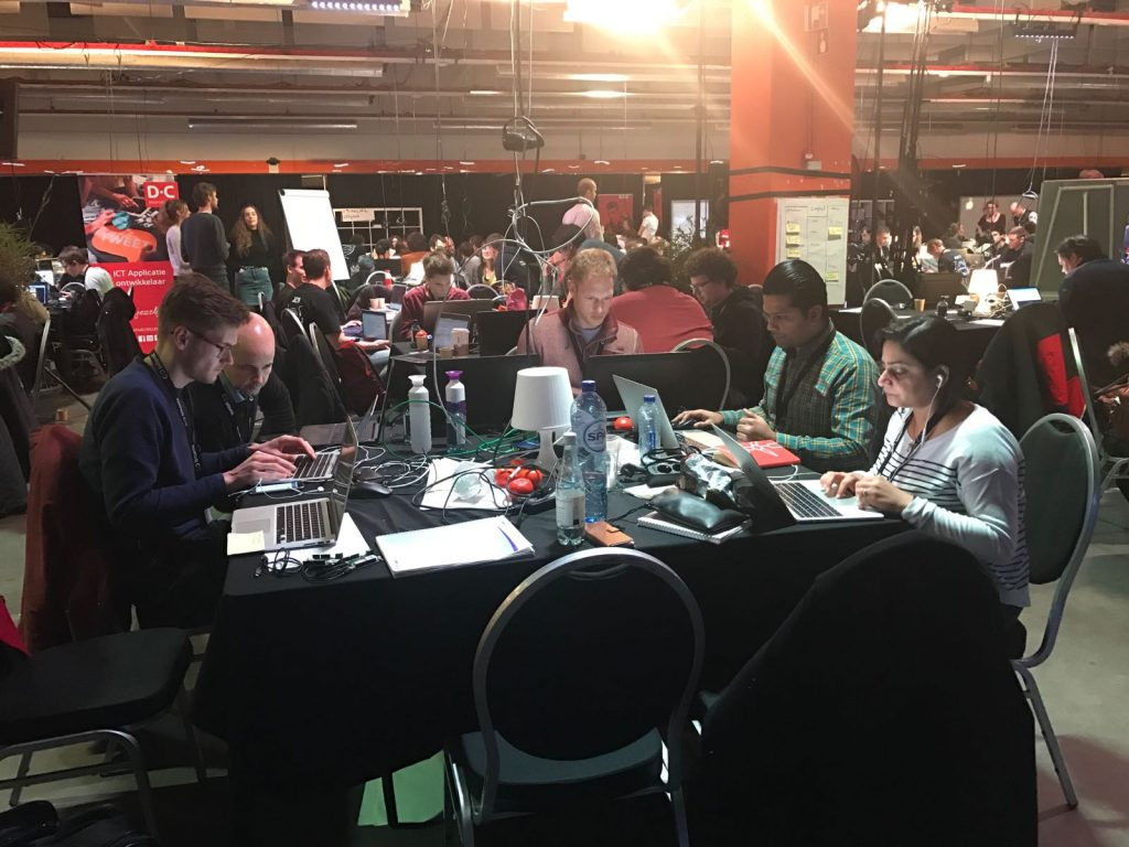 Working hard during the Blockchain Hackathon